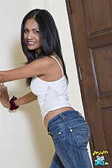 Leaning Against Wall Long Hair In Blue Jeans