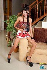 Sitting On Arm Of Sofa Wearing Black High Heels