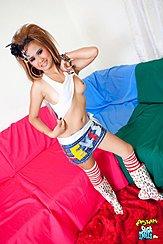 Standing Beside Sofa Raising Her Top Exposing Breast Wearing Short Skirt