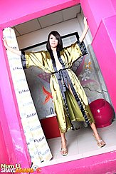 Standing In Doorway Arms Outstretched Wearing Gold Robe In High Heels