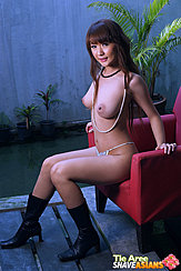 Seated Topless On Chair Big Breasts In Panties Wearing Boots