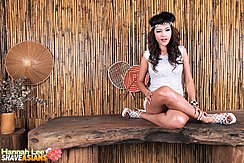 Sitting With Her Legs Crossed Wearing High Heels