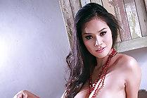 Busty Mali Tai bares big breasts and masturbates shaved pussy