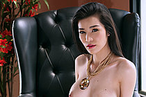 Busty Beauty Mei Mei Stripping Red Dress On Black Chair