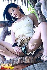 Nancy Ho Squatting On Steps Skirt Raised Thumb In Panties