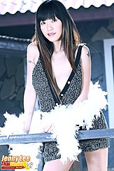 Leaning Against Fence Grey Dress Falling From Her Shoulder Holding Feather Boa