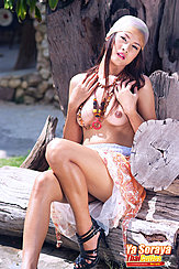 Seated On Log Topless Knee Raised Wearing High Heels