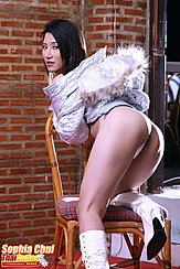 Sophia Chui Kneeling On Chair Looking Back Wearing Jacket In Panties Wearing White High Heeled Boots
