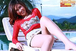Reclining On Sun Lounger Wearing Short Skirt