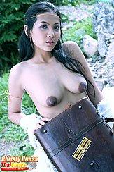 Behind Suitcase Bare Breasts Wide Brown Nipples
