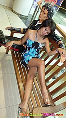 Seated On Bench Legs Crossed Wearing Clear High Heels