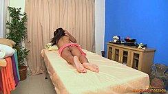 Raya Lying On Massage Table Bare Feet