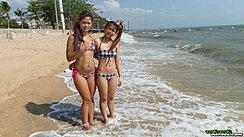Girls Standing In Beach Surf Wearing Bikinis