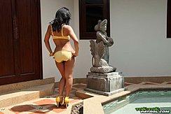 Nuch Standing Beside Swimming Pool Wearing Bikini In High Heels